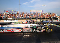 Jul. 18, 2014; Morrison, CO, USA; NHRA top fuel driver Larry Dixon (near lane) races alongside Terry McMillen during qualifying for the Mile High Nationals at Bandimere Speedway. Mandatory Credit: Mark J. Rebilas-