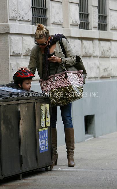 WWW.ACEPIXS.COM . . . . .  ....April 27 2010, New York City....Actress Kate Hudson walks with her son Ryder to her house in Soho on April 27 2010 in New York City. Ryder, who was on a scooter, hid behind a dumpster and had to be fished out by Hudson before disappearing into their house.....Please byline: NANCY RIVERA- ACEPIXS.COM.... *** ***..Ace Pictures, Inc:  ..Tel: 646 769 0430..e-mail: info@acepixs.com..web: http://www.acepixs.com