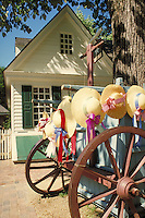 straw hats displayed on cart outside of colonial building at Williamsburg historic site. Williamsburg Virginia USA.