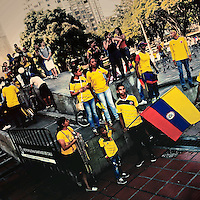 Colombia football fans watch the football match between Colombia and Uruguay at the FIFA World Cup 2014, in a park in Cali, Colombia, 28 June 2014.