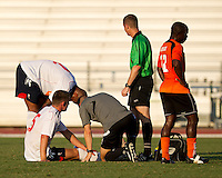 Bolton Wanderers player Gary Cahill is tended to by the trainer after a hard collision.  The Charlotte Eagles currently in 3rd place in the USL second division play a friendly against the Bolton Wanderers from the English Premier League.