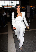 Kim Kardashian at the Los Angeles airport, departing to Paris