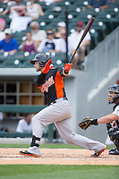 Christian Walker (22) of the Norfolk Tides follows through on his swing against the Charlotte Knights at BB&T BallPark on June 7, 2015 in Charlotte, North Carolina.  The Tides defeated the Knights 4-1.  (Brian Westerholt/Four Seam Images)