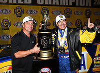 Nov 12, 2016; Pomona, CA, USA; NHRA funny car driver Ron Capps celebrates with brother Jon Capps after clinching the 2016 funny car world championship during qualifying for the Auto Club Finals at Auto Club Raceway at Pomona. Mandatory Credit: Mark J. Rebilas-USA TODAY Sports