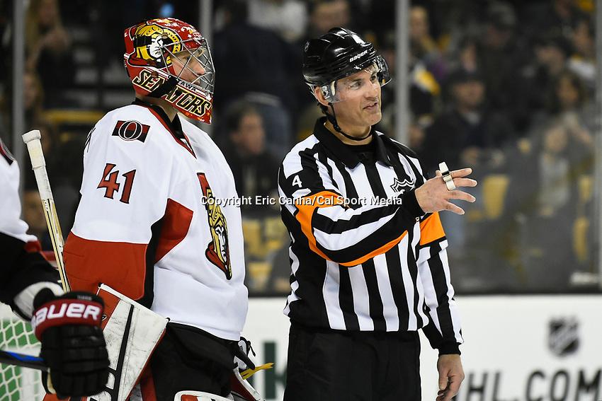 January 3, 2015 - Boston, Massachusetts, U.S. - NHL referee Wes McCauley (4) talks to Ottawa Senators goalie Craig Anderson (41) during the NHL game between the Ottawa Senators and the Boston Bruins held at TD Garden in Boston Massachusetts. Eric Canha/CSM