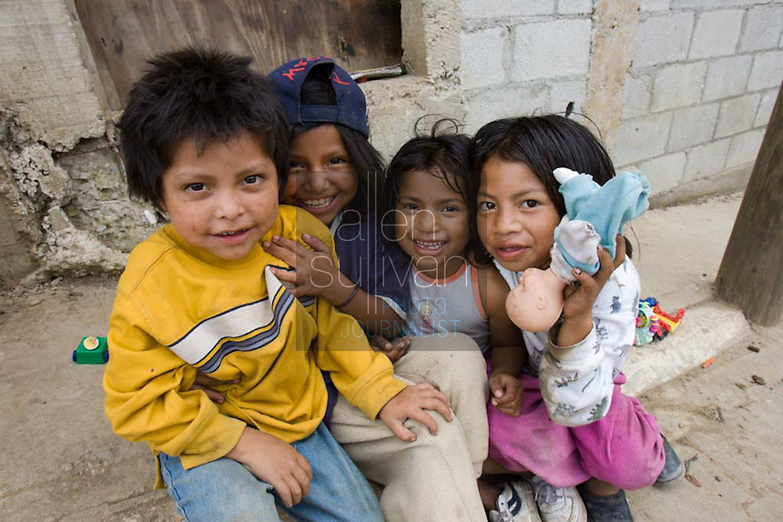 Children in of Guatemala City's massive trash dumps, where people make a meager income rummaging for recyclable debris.