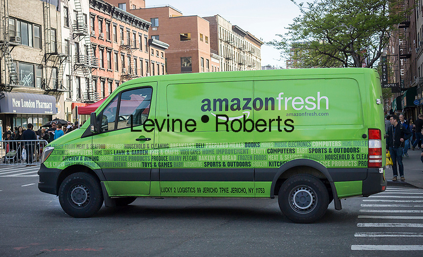 An Amazon Fresh grocery delivery service van in Chelsea in New York on Wednesday, Saturday, April 30, 2016. Online grocery deliveries is considered to be one of the hottest segments of retail.   (© Richard B. Levine)