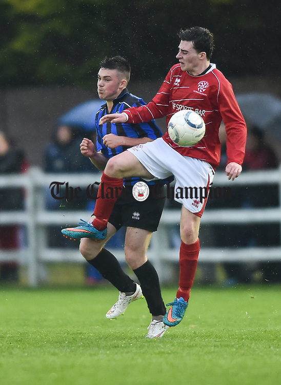 Darren Murphy of Bridge United in action against Ian Collins of Newmarket Celtic during their Cup final at Doora. Photograph by John Kelly.