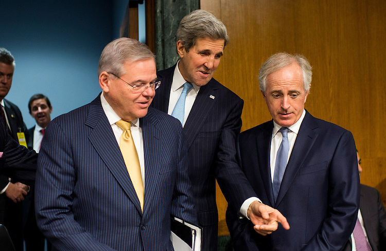 """UNITED STATES - DECEMBER 9: From left, chairman Bob Menendez, D-N.J., Secretary of State John Kerry and ranking member Bob Corker, R-Tenn., arrives for the Senate Foreign Relations Committee hearing on """"Authorization for the Use of Military Force Against ISIL"""" on Tuesday, Dec. 9, 2014. (Photo By Bill Clark/CQ Roll Call)"""