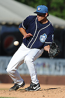Asheville Tourists starting pitcher Chris Jensen #30 reacts to a line drive during a game against the Lexington Legends at McCormick Field on May 5, 2012 in Asheville, North Carolina . The Legends defeated the Tourists 5-1. (Tony Farlow/Four Seam Images).