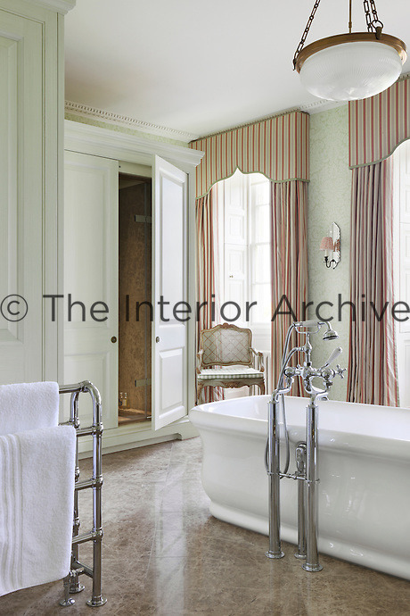 What appears to be an antique armouire is a concealed shower unit in this luxurious bathroom