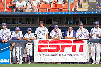 University of Washington Huskies watch from the dugout during the game against the Cal State Fullerton Titans at Goodwin Field on June 09, 2018 in Fullerton, California. The Cal State Fullerton Titans defeated the University of Washington Huskies 5-2. (Donn Parris/Four Seam Images)