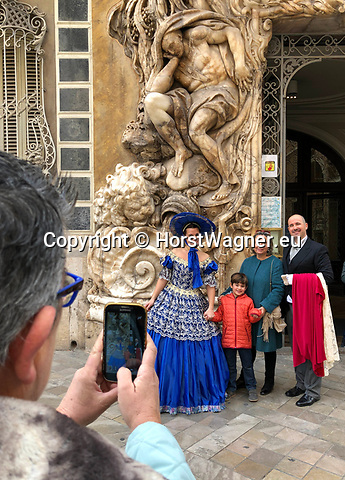 Valencia-Spain, January 14, 2018; <br /> woman in traditional, local costume poses at the rococo style - alabaster entrance of the Gonz&aacute;lez Mart&iacute; National Museum of Ceramics and Decorative Arts<br /> Photo &copy; HorstWagner.eu