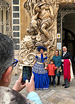 Valencia-Spain, January 14, 2018; <br /> woman in traditional, local costume poses at the rococo style - alabaster entrance of the González Martí National Museum of Ceramics and Decorative Arts<br /> Photo © HorstWagner.eu