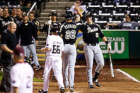 Kevin Plawecki (26) of the Purdue Boilermakers celebrates with Cameron Perkins (22) after hitting a home run during a game against the Missouri State Bears at Hammons Field on March 13, 2012 in Springfield, Missouri. (David Welker / Four Seam Images)