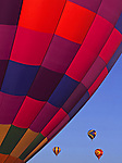 Colorful hot air balloons rise high into the sky over Tumbleweed Park during the Arizona Balloon Festival