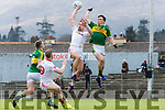 Paul Murphy Kerry prepares to punch the ball down to Peter Crowley out of Tyrone Niall Sludden hand during their National League clash in Fitzgerald Stadium on Sunday