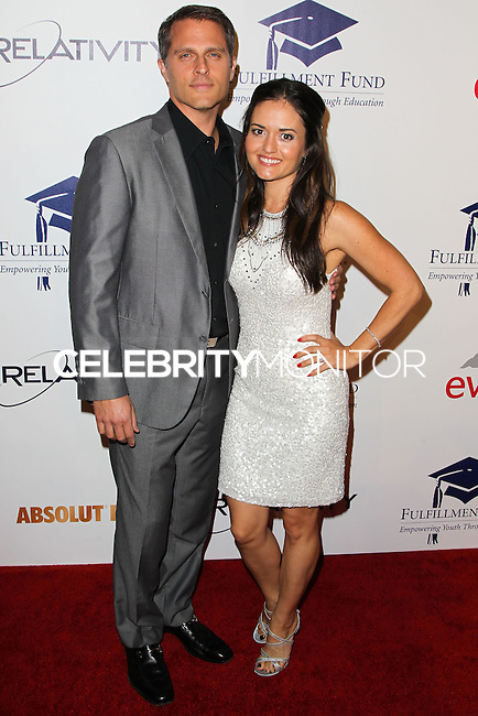 BEVERLY HILLS, CA, USA - OCTOBER 14: Scott Sveslosky, Danica McKellar arrive at the 20th Annual Fulfillment Fund Stars Benefit Gala held at The Beverly Hilton Hotel on October 14, 2014 in Beverly Hills, California, United States. (Photo by Celebrity Monitor)