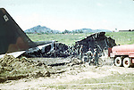 A destroyed C130 cargo plane is inspected my U.S. Army soldiers. This images is from the collection of J.W. Womble of the 610th Transportation Company during the Vietnam War.