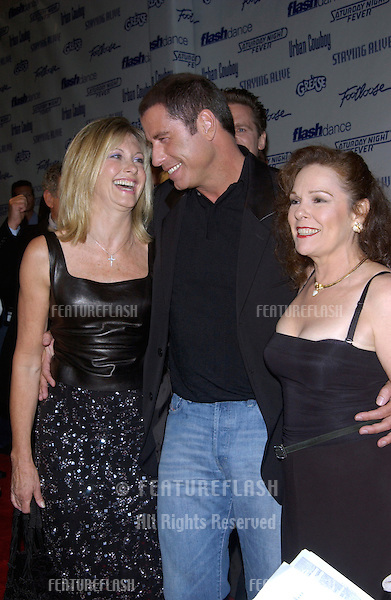 Actor JOHN TRAVOLTA (Grease, Saturday Night Fever, Urban Cowboy) with actresses OLIVIA NEWTON-JOHN (Grease) & KAREN LYNN GORNEY (right)(Saturday Night Fever) at Paramount Reunion party in Hollywood. .The party was held to celebrate the DVD release of Paramount musicals Saturday Night Fever, Grease, Flashdance, Footloose, Urban Cowboy, and Staying Alive..24SEP2002.  © Paul Smith / Featureflash