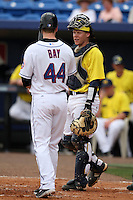 March 21, 2010:  Catcher Chris Berset (10) of the Michigan Wolverines in the field as Jason Bay (44) of the NY Mets prepares to hit during a game at Tradition Field in St. Lucie, FL.  Photo By Mike Janes/Four Seam Images