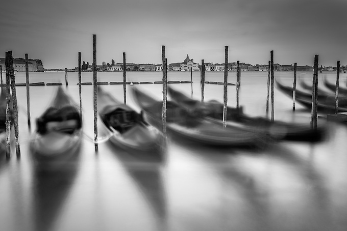 A surreal interpretation of gondola resting on a windy and rainy afternoon in Venice.