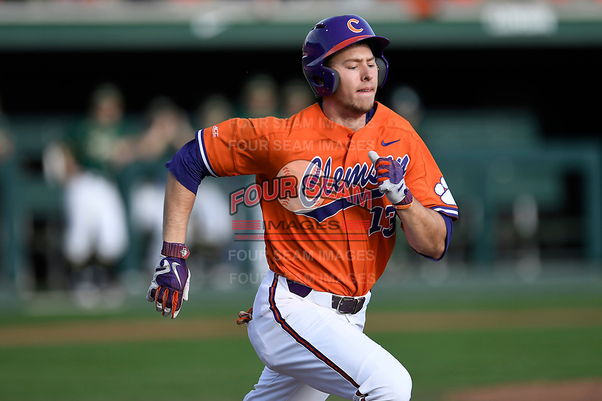 Left fielder Drew Wharton (13) of the Clemson Tigers runs out a batted ball in a game against the William and Mary Tribe on February 16, 2018, at Doug Kingsmore Stadium in Clemson, South Carolina. Clemson won, 5-4 in 10 innings. (Tom Priddy/Four Seam Images)
