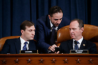 United States Representative Adam Schiff (Democrat of California), Chairman, US House Permanent Select Committee on Intelligence (R), Democratic legal counsel Daniel Goldman (L) and a staff member talk during closing statements of the House Permanent Select Committee on Intelligence public hearing on the impeachment inquiry into US President Donald J. Trump, on Capitol Hill in Washington, DC, USA, 19 November 2019. The impeachment inquiry is being led by three congressional committees and was launched following a whistleblower's complaint that alleges US President Donald J. Trump requested help from the President of Ukraine to investigate a political rival, Joe Biden and his son Hunter Biden.<br /> Credit: Shawn Thew / Pool via CNP/AdMedia