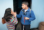 Maria Fuentes (left), head of the Escuela de Helen Keler for the deaf and blind in Lima, Peru, communicates with her student, Eslee Rameriz , by writing on his hand.