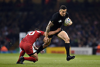Sonny Bill Williams of New Zealand looks to get past Lasha Malaguradze of Georgia. Rugby World Cup Pool C match between New Zealand and Georgia on October 2, 2015 at the Millennium Stadium in Cardiff, Wales. Photo by: Patrick Khachfe / Onside Images