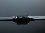 Shiny steel Apple Watch series 2 smartwatch with digital crown side view isolated on black background