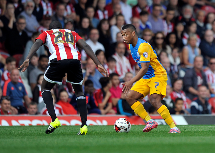 Preston North End's Chris Humphrey battles with Brentford's Toumani Diagouraga<br /> <br /> Photographer Ashley Western/CameraSport<br /> <br /> Football - The Football League Sky Bet Championship - Brentford v Preston North End - Saturday 19th September 2015 - Griffin Park - London<br /> <br /> &copy; CameraSport - 43 Linden Ave. Countesthorpe. Leicester. England. LE8 5PG - Tel: +44 (0) 116 277 4147 - admin@camerasport.com - www.camerasport.com
