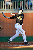 Dane Opel #47 of the Missouri Tigers follows through on his swing against the Charlotte 49ers at Robert and Mariam Hayes Stadium on February 25, 2011 in Charlotte, North Carolina.  Photo by Brian Westerholt / Four Seam Images