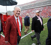 NWA Media/ J.T. Wampler - Longtime University of Arkansas athletic director Frank Broyles leaves the field Saturday Oct. 11, 2014 after being honored with the 1964 National Championship Arkansas Razorback team which he coached.