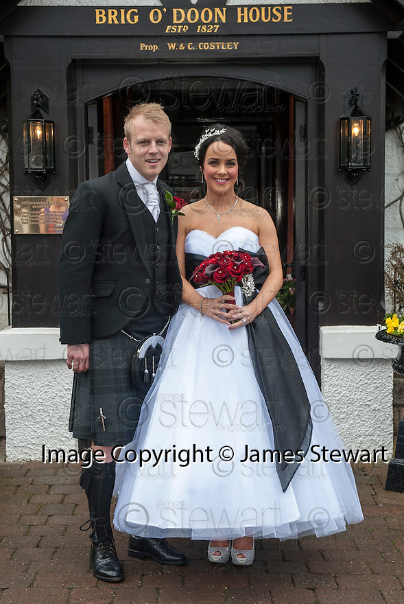 Scotland and Everton player Steven Naismith with his new wife, Moya Jane Farrell, pose outside the Brig O'Doon House Hotel, Alloway, after the ceremony.