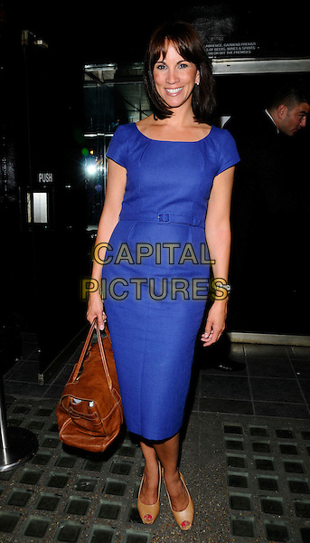 "ANDREA McLEAN.Attending Penny Smith's ""Coming Up Next"" Book Launch Party, Glass Bar,.Glasshouse Street, London, England, UK, June 24th 2008..full length blue purple belt dress brown bag peep toe beige shoes.CAP/CAN.©Can Nguyen/Capital Pictures"