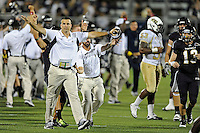 17 September 2011:  FIU Head Football Coach Mario Cristobal takes the field as time expires as the FIU Golden Panthers defeated the University of Central Florida Golden Knights, 17-10, at FIU Stadium in Miami, Florida.