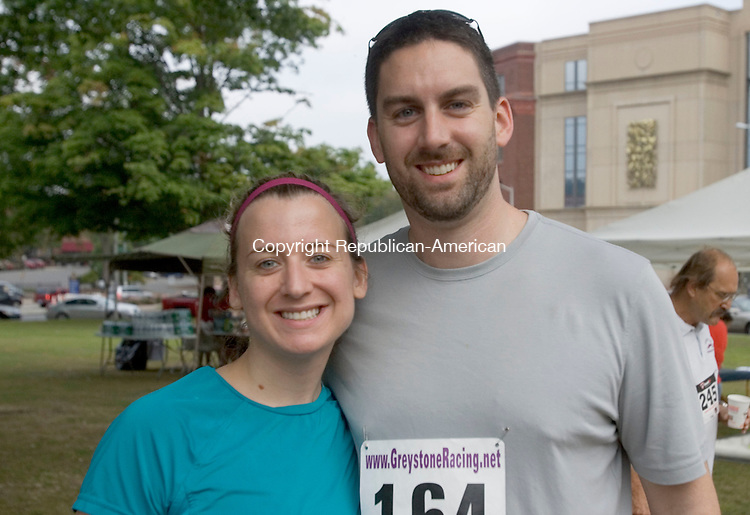 WATERBURY CT. 06 September 2014-090614SV15-Kristin and Mark Veillette of Naugatuck attend the Bob Veillette 5K Road Race in Waterbury Saturday. <br /> Steven Valenti Republican-American