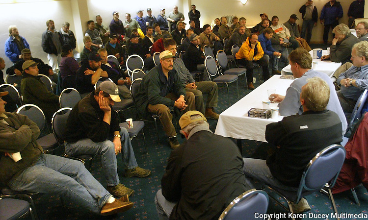 10/11/03 crab NWS::  On October 11, 2003 crab captains gather for a meeting with the board of the Alaska Marketing Association (AMA)(right) who represents them negotiating prices with the seafood companies, in Dutch Harbor, Alaska on October 11, 2003.  According to the AMA 90% of the crab caught in the Bering Sea is sold to 7 processing companies based out of Seattle, WA.  The fishermen were very unhappy with the price offer of $5.05 per pound of red king crab but voted to go fishing anyway fearing they had no choice.