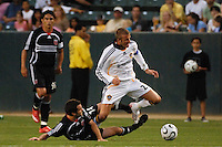 Los Angeles Galaxy midfielder (23) David Beckham gets taking down by D.C. United midfielder (14) Ben Olsen during the first half at the Home Depot Center in Carson, CA on Wednesday, August 15, 2007. The Los Angeles Galaxy defeated D. C. United 2-0 in a SuperLiga semifinal match.
