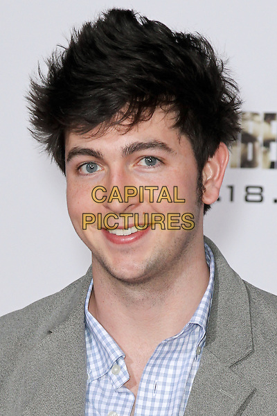 "NICHOLAS BRAUN.World premiere of DreamWorks Pictures' ""I Am Number Four"" at the Village Theatre in Westwood. Los Angeles, CA, USA. February 9th, 2011.headshot portrait grey gray white blue check.CAP/CEL .©CelPh/Capital Pictures"