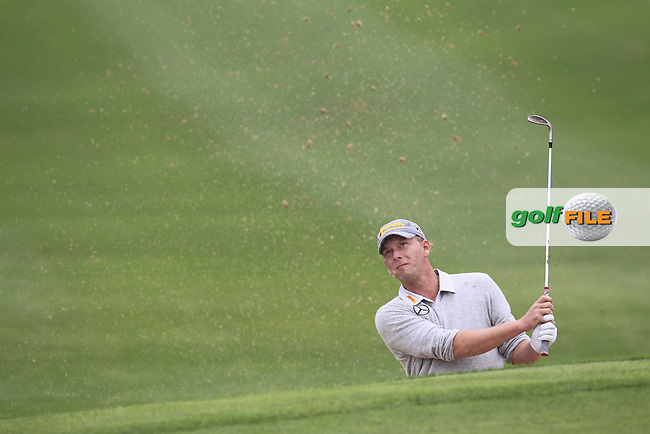 Marcel Siem (GER) chips from a bunker at the 1st green during Saturay's Round 3 of the 2014 BMW Masters held at Lake Malaren, Shanghai, China. 1st November 2014.<br /> Picture: Eoin Clarke www.golffile.ie