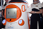 """August 01 2012, Tokyo, Japan - The new robot guide """"Tawabo"""" shows its employee ID in the ceremony. Tokyo Tower implemented the new robot guide which name is """"Tawabo"""", the first indoor robot guide in Japan. It can speak Japanese, English, Chinese and Korean, it weights 200kg and it is 160cm tall."""