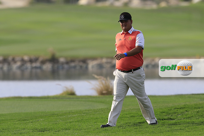 Prom Meesawat (THA) walks to the 15th green during Wednesday's Round 1 of the 2016 Commercial Bank Qatar Masters held at the Doha Golf Club, Doha, Qatar. 26th January 2016.<br /> Picture: Eoin Clarke | Golffile<br /> <br /> <br /> All photos usage must carry mandatory copyright credit (&copy; Golffile | Eoin Clarke)