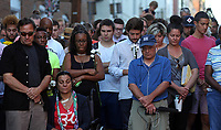 A moment of silence during a large vigil for Heather Heyer Sunday night at 4th Street SE and Water Street in Charlottesville, Va. Heyer was killed and 19 others injured when a car intentionally ran through a crowd of counter protestors after the Unite The Right rally. Photo/Andrew Shurtleff/The Daily Progress