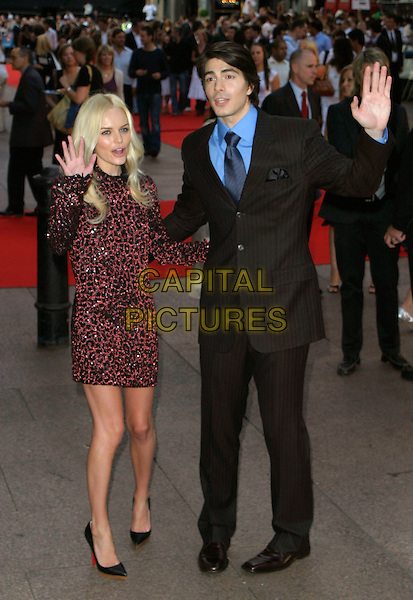 "KATE BOSWORTH & BRANDON ROUTH.""Superman Returns"" UK film premiere, Odeon Leicester Square, London, UK..July 13th, 2006.Ref: AH.full length dress black jewel encrusted black pink red sequins sequined sequin dress suit hand waving.www.capitalpictures.com.sales@capitalpictures.com.© Capital Pictures."