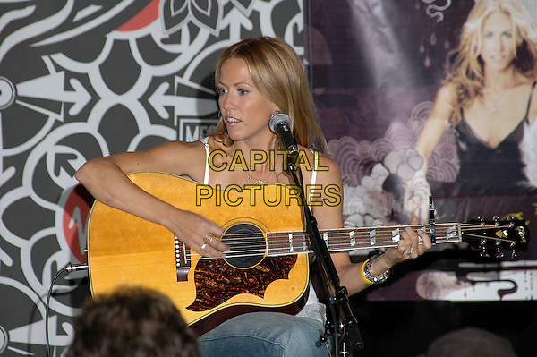 "SHERYL CROW.In concert at the Virgin Megastore in New York's Times Square to promote her new CD ""Wildflower"", and to sign copies for her fans, New York, New York..September 28th, 2005.Photo Credit: Patti Ouderkirk/AdMedia/Capital Pictures.Ref: PO/ADM.half length gig performance guitar.www.capitalpictures.com.sales@capitalpictures.com.© Capital Pictures."