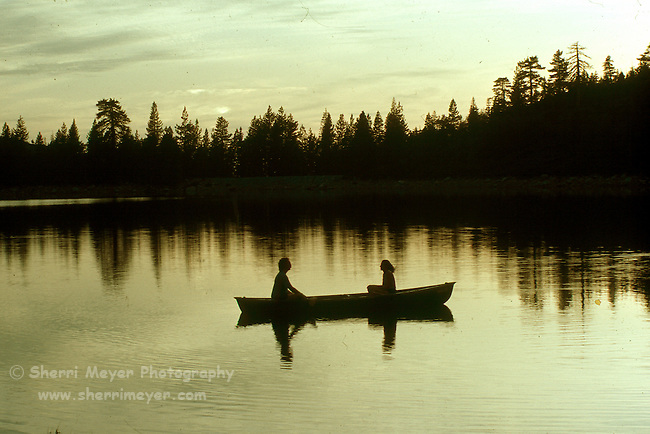 Silhouette of a couple canoeing on Blue Lake
