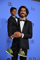 Dev Patel &amp; Sunny Pawar at the 74th Golden Globe Awards  at The Beverly Hilton Hotel, Los Angeles USA 8th January  2017<br /> Picture: Paul Smith/Featureflash/SilverHub 0208 004 5359 sales@silverhubmedia.com