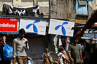 People walk past advertising for Uninor on a street in Mumbai. Telenor warned it could be forced to reconsider its presence in India if the New Delhi revises the terms of its spectrum licence amid a political scandal over regulation of the Indian telecoms industry.<br /> <br /> Unitech, since renamed Uninor, is one of five companies alleged to have benefited from irregularities that an official audit claimed had cost the Indian government $39bn in lost revenues from spectrum licences. <br /> <br /> Further reading : http://www.ft.com/cms/s/0/f391ebb0-33b4-11e0-b1ed-00144feabdc0.html#axzz1DWW1eUZh